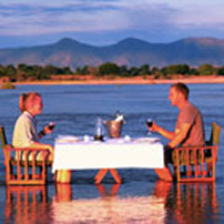 Romantic dinner in Kapamba River, South Luangwa, Zambia