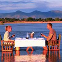 Romantic dinner in Kapamba River, South Luangwa, Zambia