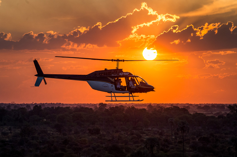 All About Safaris helicopter horizons botswana sunrise