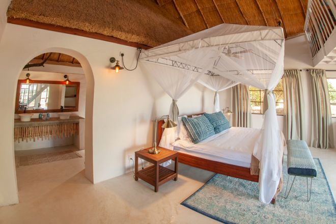 Kafunta River Lodge Luxury Suite Bedroom and Bathroom
