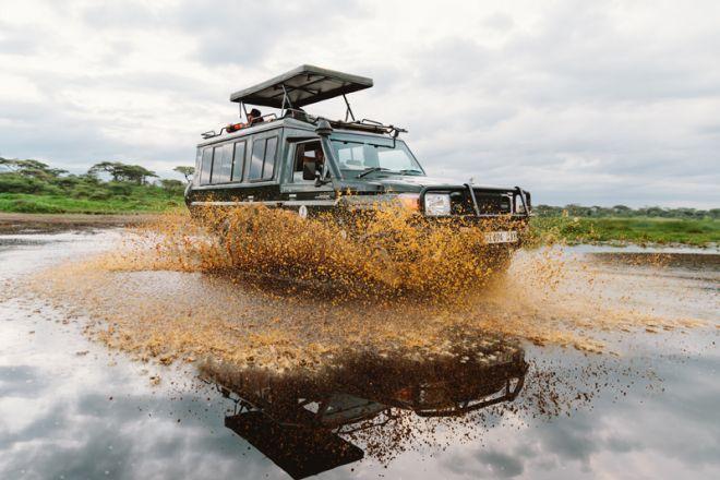 Kirurumu Serengeti Camp game drive through water