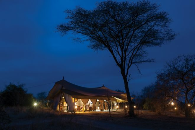 Kwihala Tented Camp mess tent at night