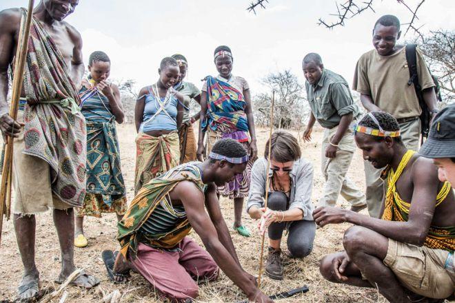 Mwiba Lodge culture Hadzabe making fire