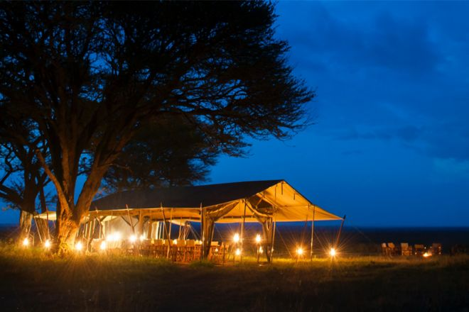 Serengeti Safari Camp central tent at night