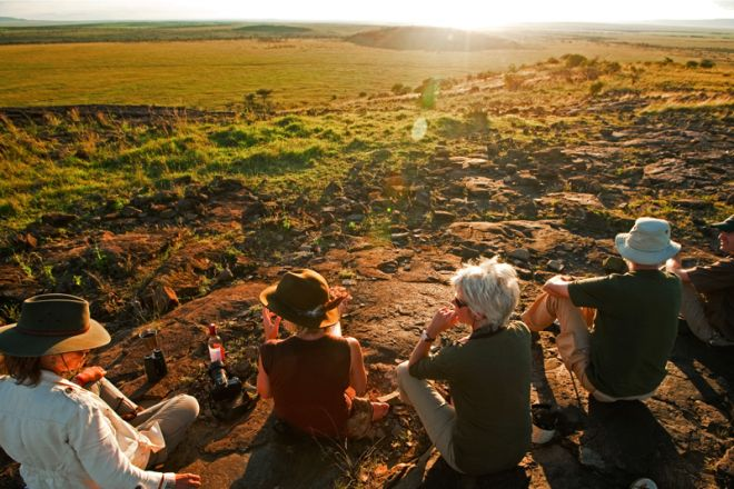 Mara Plains Camp Sundowner on rock