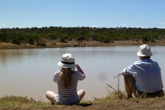 Sosian family watching elephants at acacia dam