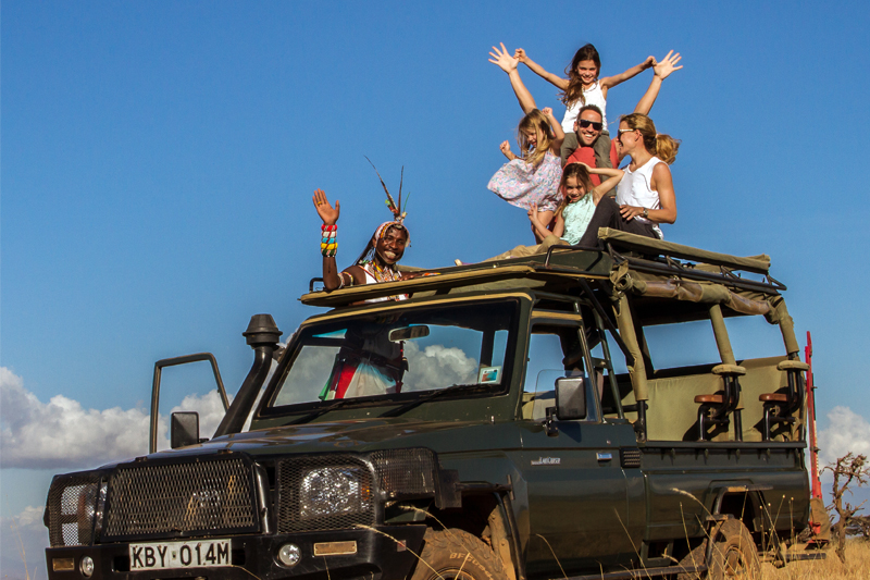 Home page family kids on game drive